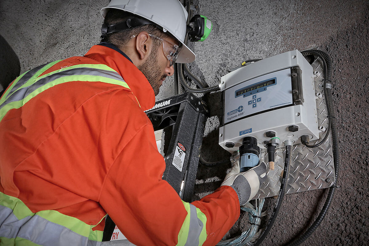 Image of an MDM technician installing the Vigilante AQS underground