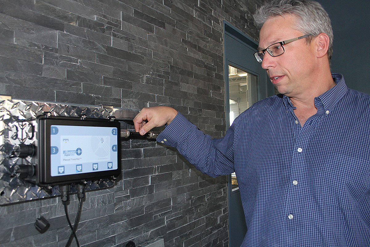 Image of David Ballantyne, vice-president of product development, with a Plexus Powernet, which is currently running a lighted sign in Maestro Digital Mine's office in Lively.
